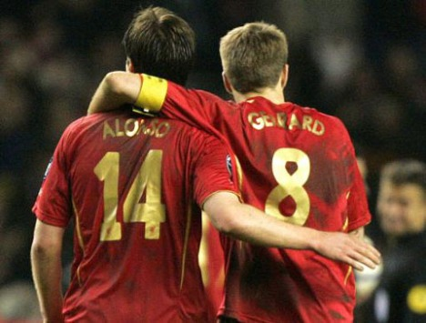 Liverpool's Steven Gerrard, right, and Xabi Alonso trudge from the field after their 2-0 loss to Benfica in their Champion's League knock out round second leg soccer match at Anfield Stadium, Liverpool, England, Wednesday March 8, 2006. (AP Photo/Dave Thompson)